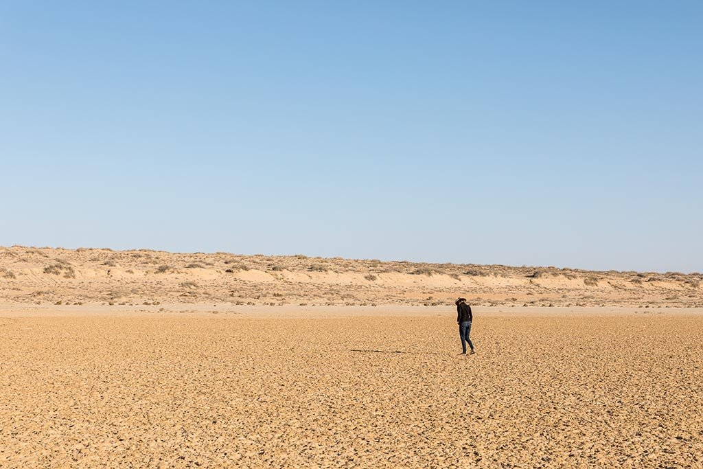 Marianne walking across the dry surface of Lake Eyre