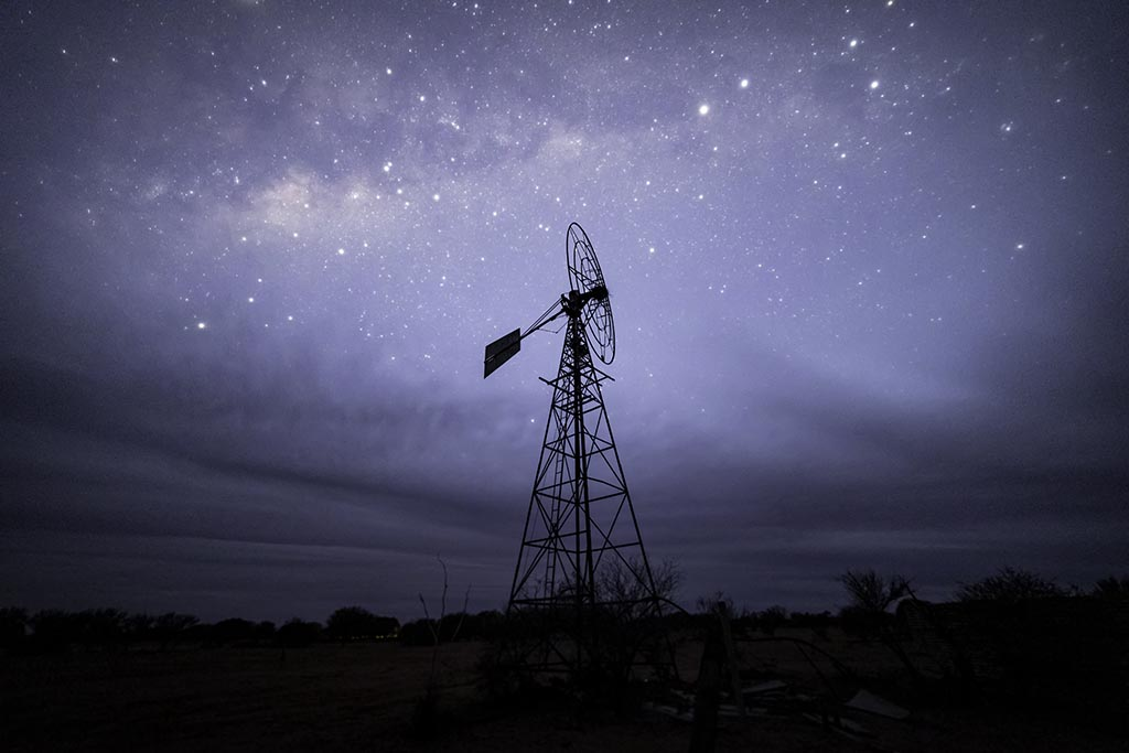 A derelict windmill under the stars in the Sturt National Park