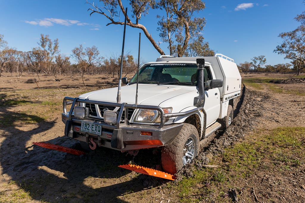 GU Patrol Ute bogged in the mud