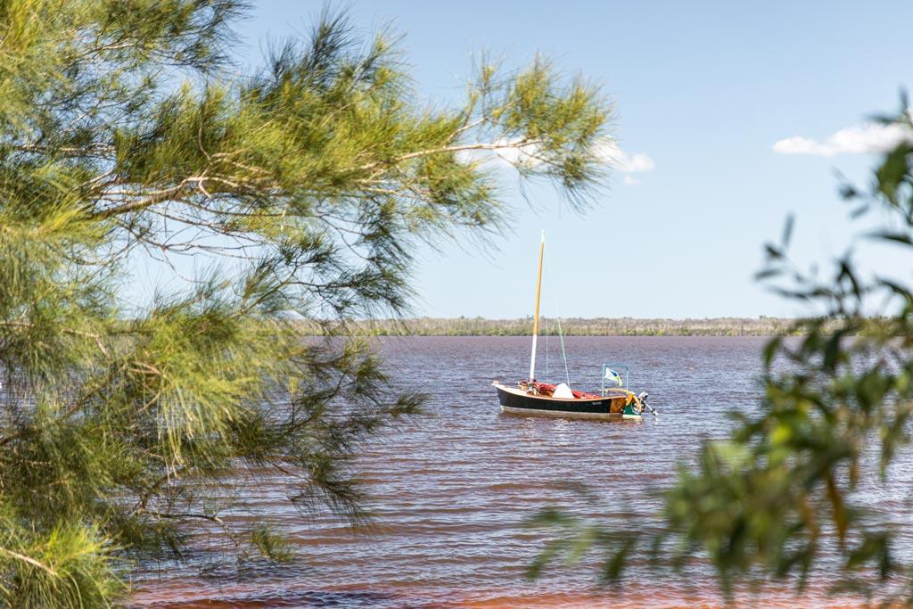 A small sailing boat on Lake Cootharaba - Sunshine Coast Hinterland Towns