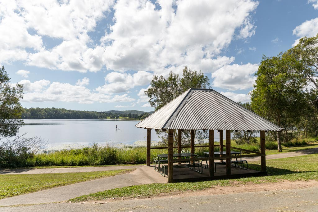 Picnic shelter with Lake MacDonald in the background - Sunshine Coast Hinterland Towns