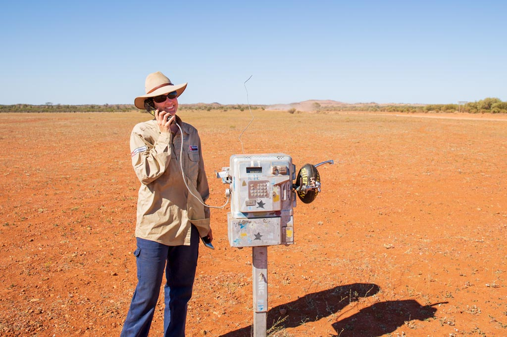Mez on a payphone in the middle of Central Australia