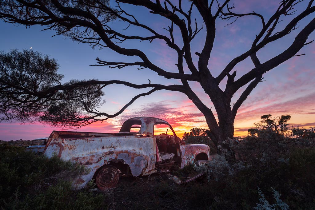 an old ute at sunrise under a tree - 6 tips to improve your landscape photography