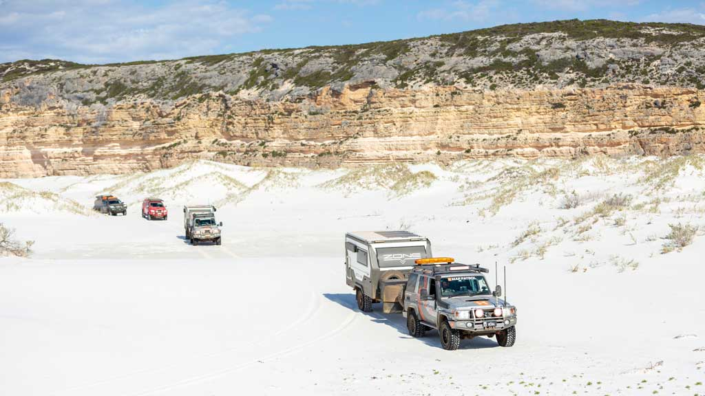 Four 4WD in a convoy on the sand - how to drive on sand