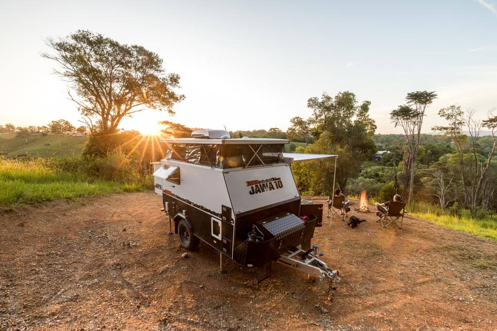 Sitting around the campfire at sunset with the JAWA TRAX 10 all set up behind