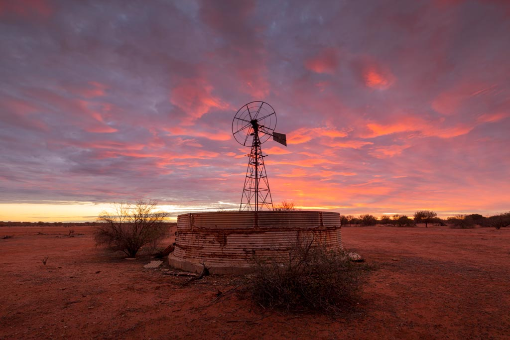 Abandoned windmill at sunset in the outback - 6 tips to improve your landscape photography