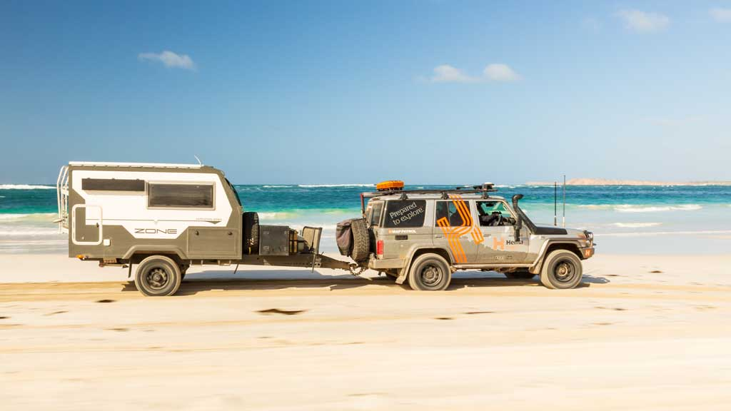 4wd towing a trailer on the sand - how to drive on sand
