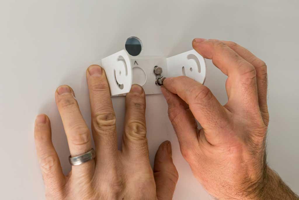 putting bolts through a bracket