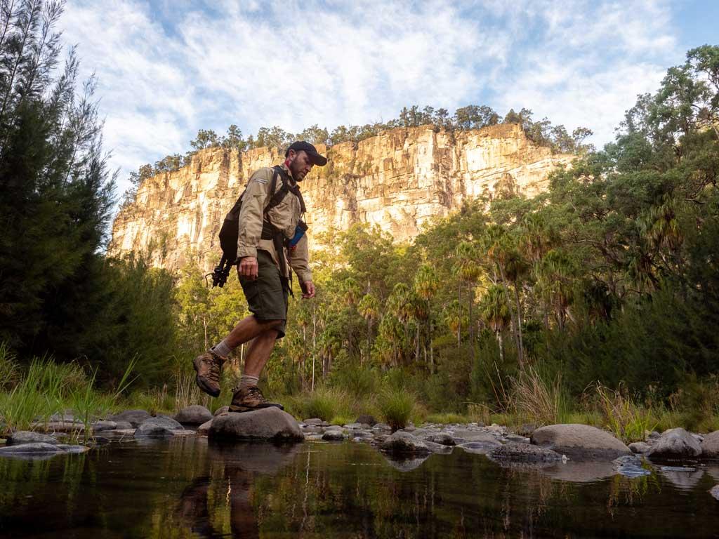 Man walking across Carnarvon Creek