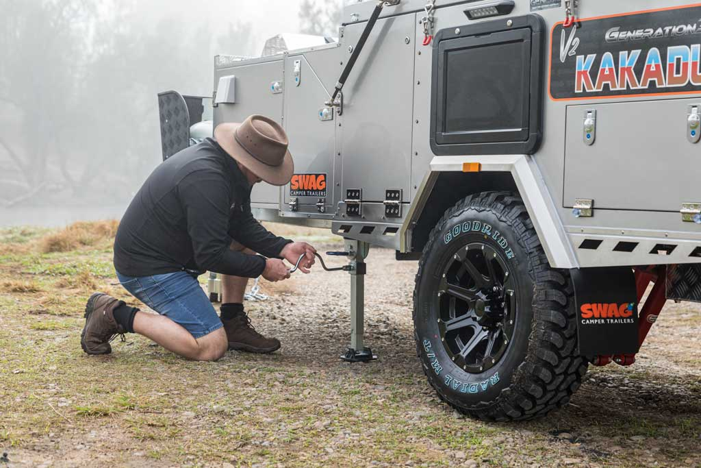 Levelling the camper trailer at camp