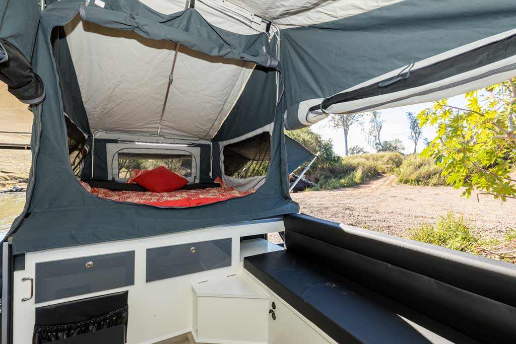 View of the inside of the forward fold camper trailer through the panorama windows