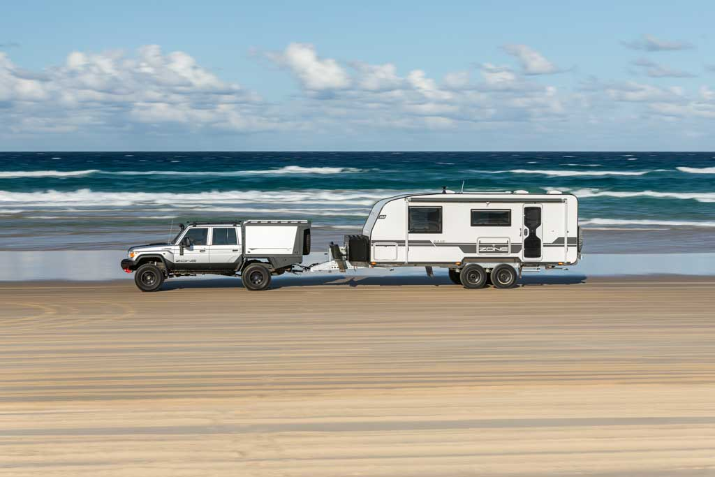 towing a caravan along the beach